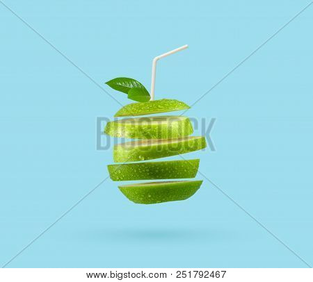 Ripple Cut Fruit Juice With Straw On Green