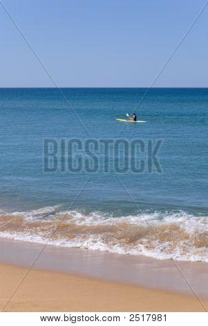 Beautiful Beach And Kayaker