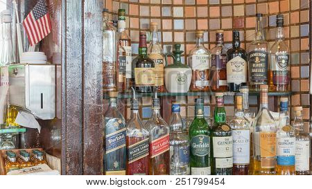 Assortment Of Liquor Alcoholic Drink With American Flag In Irish Pub, San Francisco
