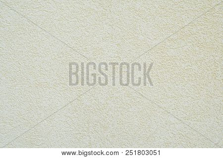 Background Wall With Off-white Or Pale Yellow Roughcast Plaster Texture