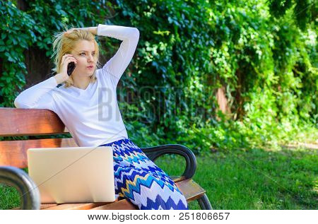 Woman With Laptop Works Outdoors. Business Woman Works Park With Laptop Smartphone. Girl Smartphone