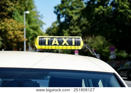German Taxi Sign On Car Roof In Germany, Travel Transport Concept