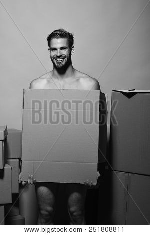 Sexuality And Moving Concept. Macho With Smiling Face Covers Nudity. Man With Beard Stands On Pink B