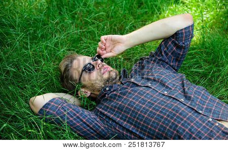Nature Fills Him With Freshness And Inspiration. Man Unshaven Guy Lay On Green Grass Meadow. Natural