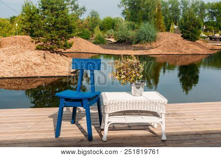 Place For Chillout Outdoor On Lake With Pier And Chair