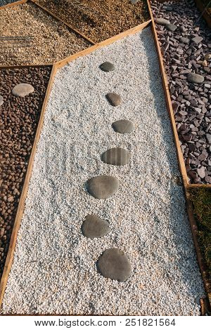 Japanese Pebbles On The Dust Outdoor At Bright Light