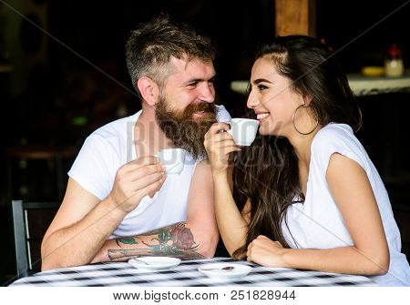Pleasant coffee break. Couple in love drink black espresso coffee in cafe. Drinking black coffee has numerous health benefits loaded with antioxidants and nutrients. Couple enjoy hot espresso. poster
