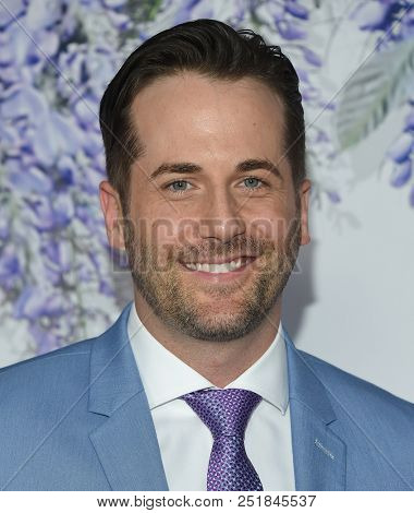 LOS ANGELES - JUL 26:  Niall Matter arrives to the Hallmark Channel Summer TCA Event  on July 26, 2018 in Hollywood, CA