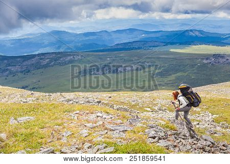 Atmospheric Moment In Mountains. Hiking Woman With Backpack Traveler On Top Of Mountains. Stylish Wo