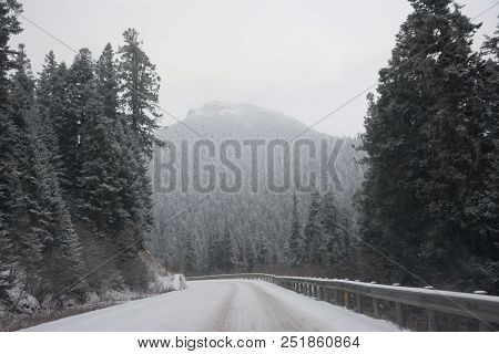 Mountain Snow Landscape Nature China, Asia. The Road Covered With Snow In The Mountains. Road In The