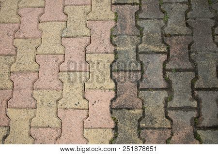 Contrast Between Patio Paving Slabs Which Have Been Pressured Washed Before And After Cleaning