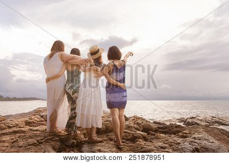 Summer Lifestyle Of Four Pretty Women Having Fun And Relax On Beach. Point To Copy Space. Summer Con