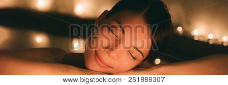 Luxury spa massage woman. Pampering whirlpool jacuzzi lifestyle girl relaxing in hot water banner panorama. poster