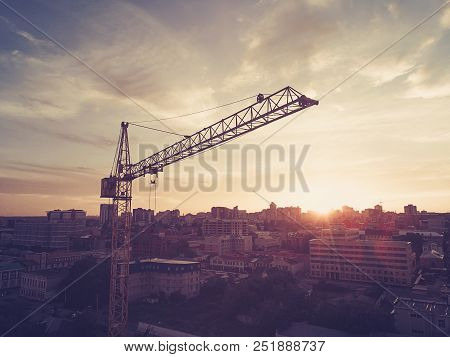 High Yellow Crane Building A House In The Beautiful Blue Sky With Clouds. Workers In The Building Un