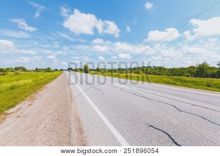 An empty road in the countryside. Sunny day and gorgeous scene. Location place Ukraine, Europe. Active outdoor vacation. Scenic image of european travel destination. Discover the beauty of earth.