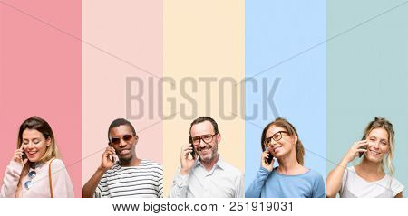 Mixed group of people, women and men happy talking using a smartphone mobile phone