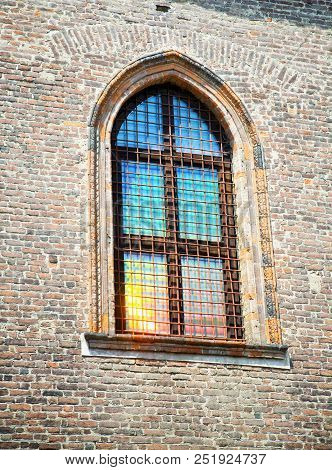 Old Window With Sun Reflection