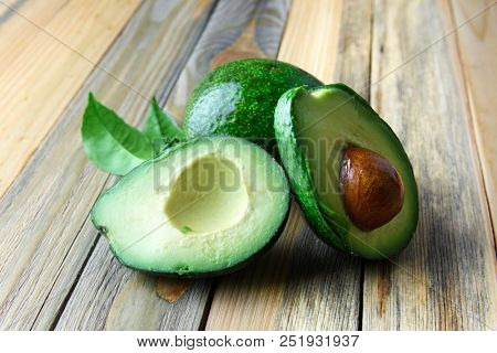 Fresh avocado fruit on a wooden board. The concept of healthy eating. Food photography