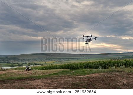 High Technological Innovation To Improve Productivity In Agriculture. A Drone Flies Over The Farmer'