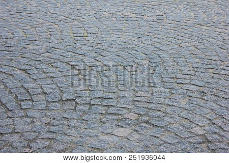 Cobblestone Pavement Textured Pattern Of Narrow Retro Street. Old Town Square Fragment With Road Det