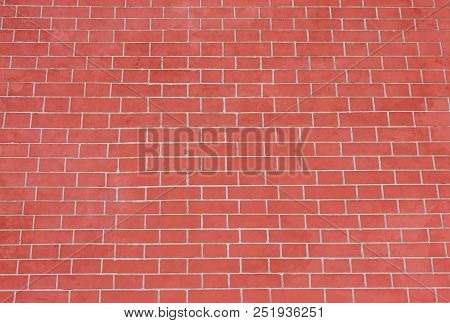 Brick Wall Pattern Of Red Stone Surface Background. Abstract Vivid Brick Stones Pattern And Backdrop