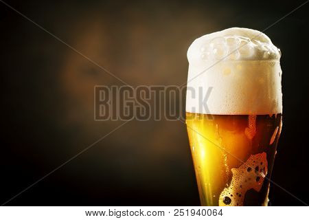 A Glass Of Beer On A Dark Background. Oktoberfest. Beer Festival. Selective Focus. Background With C