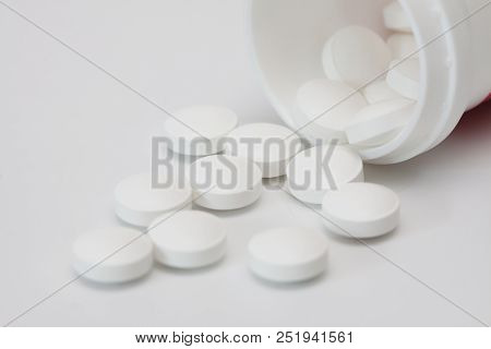 White Pills And Pill Botle.