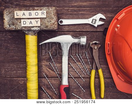 Old Tools And Wooden Letters With The Inscription Labor Day On The Background Of A Vintage, Wooden,