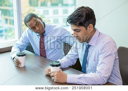Upset Coworkers Drinking Takeaway Coffee And Sharing Bad News. Afro American Employee Listening To F