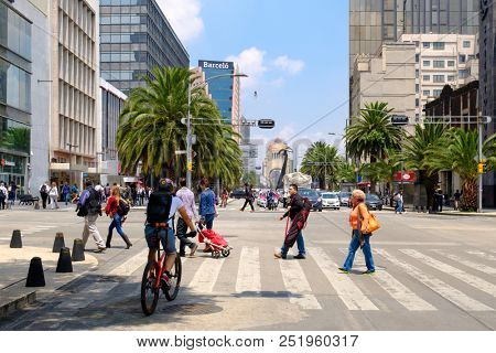 MEXICO CITY,MEXICO - JULY 12,2018 : Urban scene in Mexico City with the Monument to the Revolution on the background