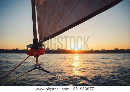 Sunset Over The City From The Sailboat. Sailboat Winch, Sail And Nautical Rope Yacht Detail. Yachtin
