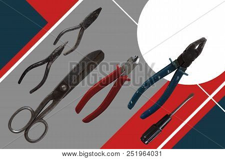 Working tool on constructivism background: screwdriver, pliers, nippers, screwdriver. Top view poster