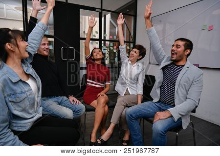 Business Concept. Businessmen Are Shouting With Joy. Business People Are Raising Their Hands For Bus