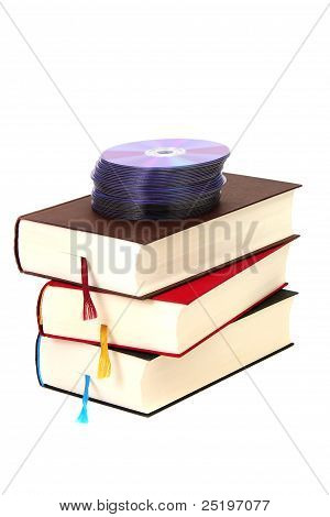 Stack Of Books With Dvds On White