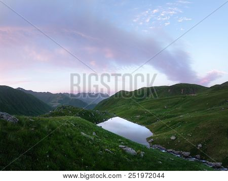 Landscape Of A Mountain Range And An Abudelauri Lake In Georgia At Sunset. Mountain Landscape At Sun