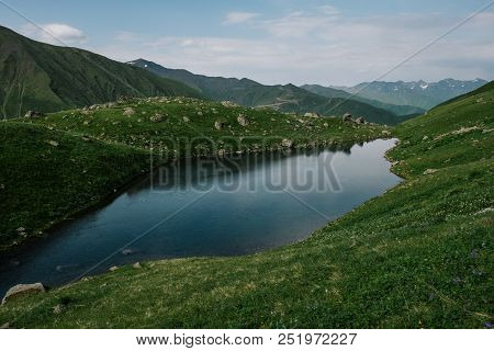 Landscape Of The Abudelauri Lake Near The Chaukhi Mountain Range In Georgia. Mountain Range At The B