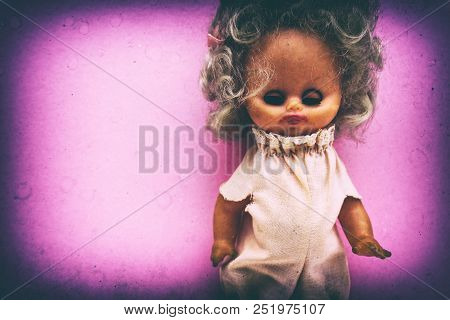 Spooky Vintage Generic Doll Portrait With Grunge Texture, Grains And Splotches.