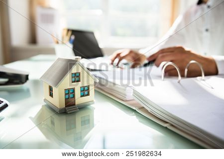 Businessman's Hand Calculating Invoice