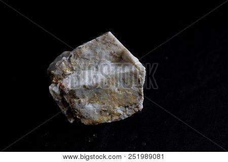 The Feldspar Stone Isolate On Black Background