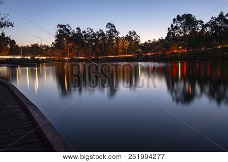 Beautiful Lake In Springfield Lakes At Dusk.