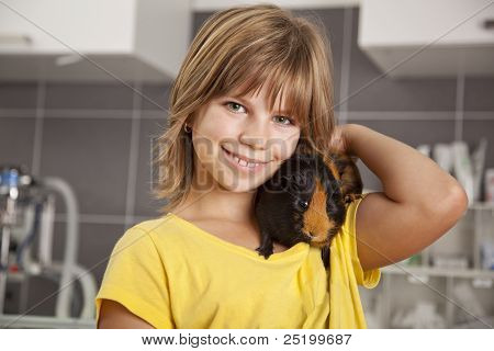 smiling girl with guinea pig