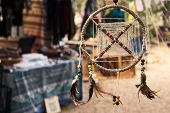 Dream catcher hanging from a tree at a bohemian festival artisan market poster