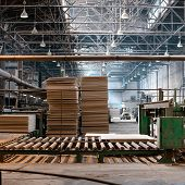 Workshop for the production of particle boards. Manufacture of chipboard, veneer, plywood, wood panels. Wood processing. Woodworking industry poster