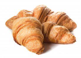 Three Fresh Baked Croissants Isolated On White Background