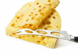 Piece Of Swiss Cheese With Knife Isolated On White Background