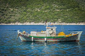 A Fishing Boat At Sea In Greece By Island Lefkada