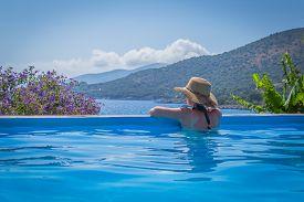 Pretty Woman Is Sunbathing In A Swimming Pool