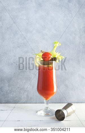Bloody Mary Cocktail In Glass With Garnishes. Tomato Bloody Mary Or Caesar Spicy Drink On Gray Backg