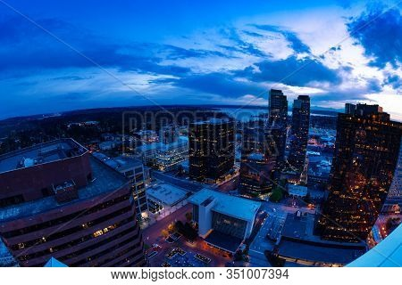 Evening Panorama Of Bellevue City Downtown Of King County, United States Across Lake Washington From
