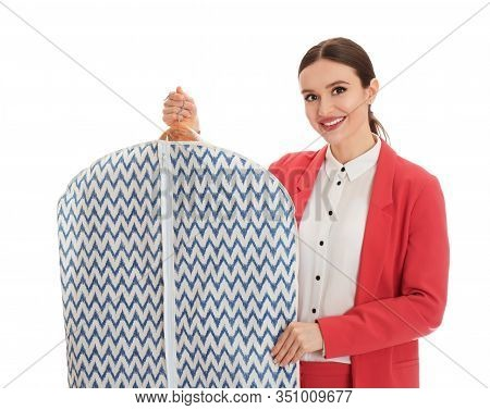 Young Woman Holding Hanger With Clothes In Garment Cover On White Background. Dry-cleaning Service